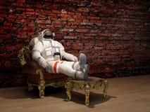 Astronaut als voorzitter Stock Foto's