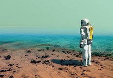 Astronaut at the sea beach, wearing a space suit on a terraformed planet royalty free stock photography