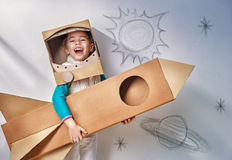 Astronaut. Child is dressed in an astronaut costume stock image