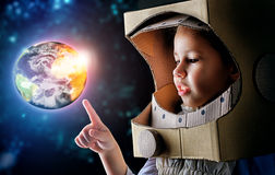 Astronaut. Child is dressed in an astronaut costume stock photo