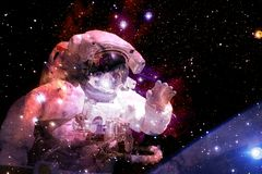 Astronaut in deep space. Elements of this image furnished by NASA. Astronaut in deep space. Cosmic art. Elements of this image furnished by NASA stock image