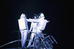 Astronaut dressed performers balance Simet Wheel during Ringling Stock Image