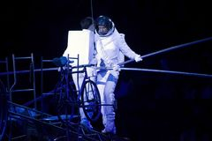 Astronaut dressed performers balance Simet Wheel during Ringling. BROOKLYN, NEW YORK - FEBRUARY 25: Laszlo Simet and family dressed as astronauts  balance on Royalty Free Stock Photos