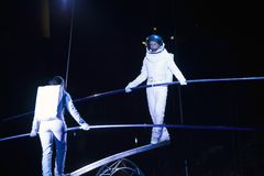 Astronaut dressed performers balance Simet Wheel during Ringling Royalty Free Stock Photography