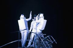 Astronaut dressed performers balance Simet Wheel during Ringling. BROOKLYN, NEW YORK - FEBRUARY 25: Laszlo Simet, wife and partner dressed as astronauts  balance Stock Images