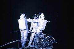 Astronaut dressed performers balance Simet Wheel during Ringling. BROOKLYN, NEW YORK - FEBRUARY 25: Lazslo Simet with wife and partner dressed as astronauts Stock Image