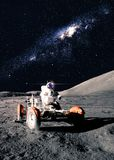 Astronaut Drives Rover Stock Photos