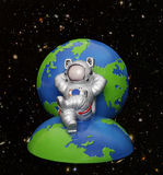 Astronaut  on Earth. A space astronaut relaxing on earth with stars and planets in the background Stock Images