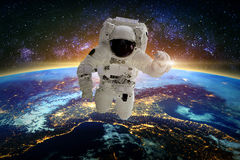 Astronaut. Elements of this image furnished by NASA. Astronaut in galaxy. Elements of this image furnished by NASA royalty free stock photo