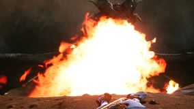 Astronaut escapes from the angry dragon. Epic scene with explosions, fire and smoke on an uncharted planet. 3D animation