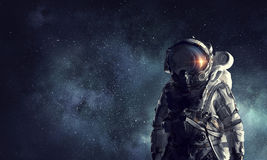 Astronaut explorer in space. Mixed media Royalty Free Stock Photos