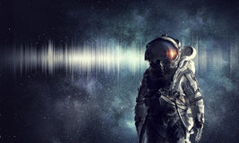 Astronaut explorer in space. Mixed media Royalty Free Stock Images