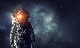 Astronaut explorer in space. Mixed media Royalty Free Stock Photo