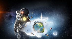 Astronaut explorer in space. Mixed media Royalty Free Stock Photos