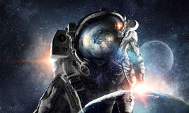 Astronaut explorer in space. Mixed media Royalty Free Stock Photography