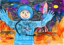 Astronaut exploring the red planet, space concept, child drawing on paper Royalty Free Stock Photography