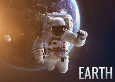 Astronaut exploring space in Earth's orbit stock photos