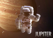 Astronaut exploring space in Jupiter orbit Stock Photos