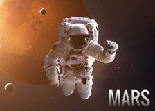 Astronaut exploring space in Mars orbit. Elements. Colorful shot that shows NASA's astronaut in open space near planet Mars. Elements of this image furnished Stock Photography