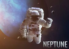 Astronaut exploring space in Neptune orbit Royalty Free Stock Images