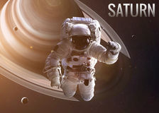 Astronaut exploring space in Saturn orbit Stock Photography