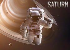 Astronaut exploring space in Saturn orbit Stock Photography