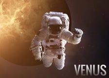 Astronaut exploring space in Venus orbit. Elements Stock Photos