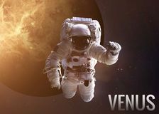 Astronaut exploring space in Venus orbit. Elements Stock Photos