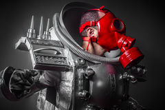 Astronaut, fantasy warrior with huge space weapon Stock Images