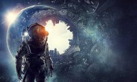 Astronaut in fantasy world. Mixed media Stock Image