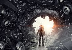 Astronaut in fantasy world. Mixed media. Astronaut against dark background with gears and cogwheels. Mixed media. Elements of this image are furnished by NASA Stock Images