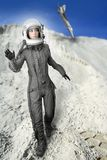 Astronaut fashion stand woman space suit helmet. Astronaut fashion womanaircraft crash space suit helmet moon landscape Royalty Free Stock Photos