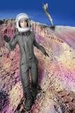 Astronaut fashion stand woman space suit helmet. Astronaut fashion womanaircraft crash space suit helmet moon landscape Stock Photo