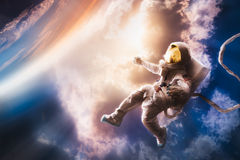 Astronaut floating in the atmosphere Stock Photos