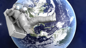 Astronaut floating over the Earth. A Astronaut floating over the earth. 3D illustration Royalty Free Stock Photo