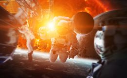 Astronaut floating in space 3D rendering elements of this image. Astronaut floating in space in front of exploding sun 3D rendering elements of this image Royalty Free Stock Images