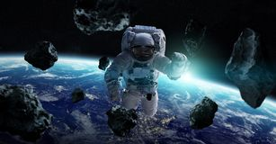Astronaut floating in space 3D rendering elements of this image. Astronaut floating in space in front of planet Earth 3D rendering elements of this image Stock Photography