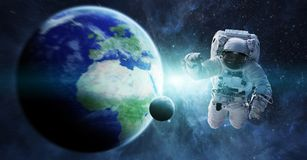 Astronaut floating in space 3D rendering elements of this image. Astronaut floating in space in front of planet Earth 3D rendering elements of this image Royalty Free Stock Photos
