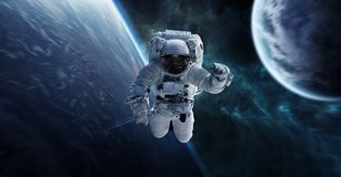 Astronaut floating in space 3D rendering elements of this image. Astronaut floating in space in front of planets 3D rendering elements of this image furnished by Royalty Free Stock Photo