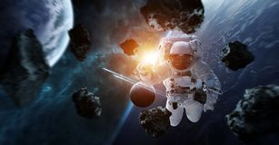 Astronaut floating in space 3D rendering elements of this image. Astronaut floating in space in front of planets 3D rendering elements of this image furnished by Stock Image