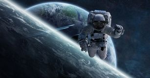 Astronaut floating in space 3D rendering elements of this image. Astronaut floating in space in front of planets 3D rendering elements of this image furnished by Royalty Free Stock Photography