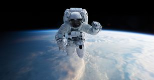 Astronaut floating in space 3D rendering elements of this image. Astronaut floating in space in front of planet Earth 3D rendering elements of this image Stock Image