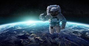 Astronaut floating in space 3D rendering elements of this image. Astronaut floating in space in front of planet Earth 3D rendering elements of this image Stock Photo