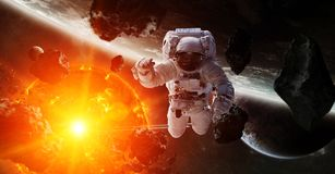 Astronaut floating in space 3D rendering elements of this image. Astronaut floating in space in front of exploding sun 3D rendering elements of this image Royalty Free Stock Photo