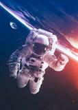 An astronaut floats above billions of stars. Stars Stock Photos