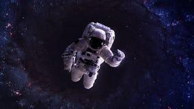An astronaut floats above billions of stars. Stars