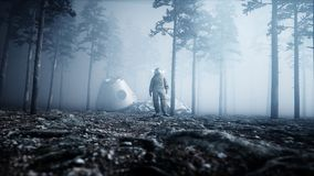 Astronaut in fog night forest. Fear and horror. landing place. 4K animation. 3d rendering. Astronaut in fog night forest. Fear and horror. landing place. 4K Stock Photos