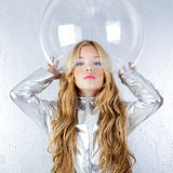 Astronaut girl with silver uniform Royalty Free Stock Image