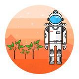 Astronaut grow plants on Mars. Stock Photo