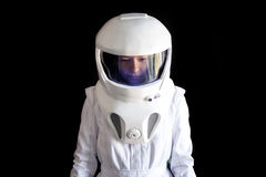 Astronaut in a helmet looks down. Fantastic space suit. Exploration of outer space. Royalty Free Stock Photos